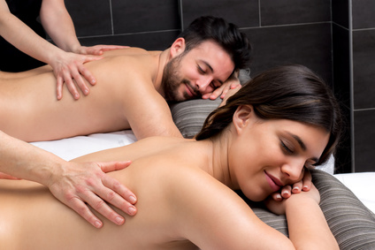 Young couple enjoying body massage together.